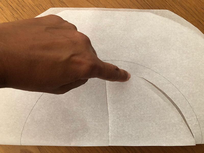 semi circular sheet of baking paper featuring initial cutout of inner circle