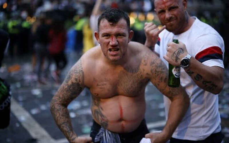 racism in England inner post imagebare-chested tattooed England fan posing aggressively for camera